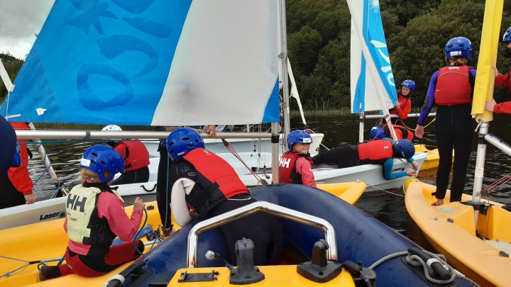 Young people and children try sailing
